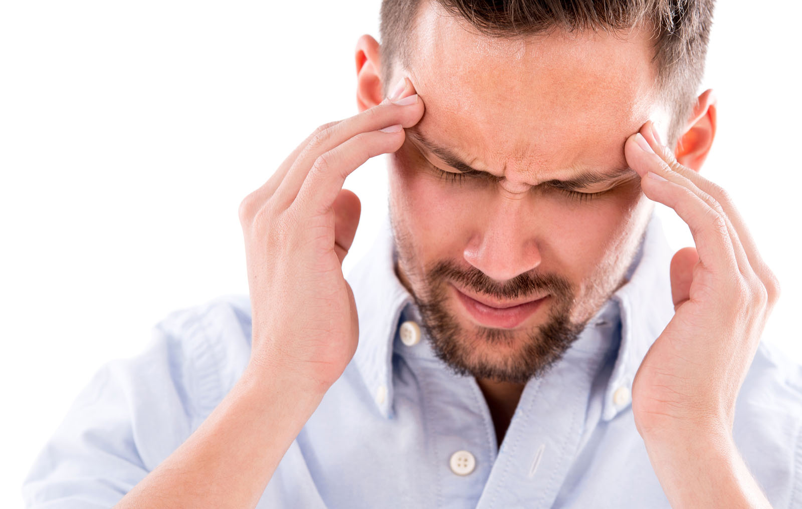 man suffering from a tension headache